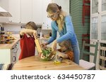 mother and kids stirring... | Shutterstock . vector #634450787