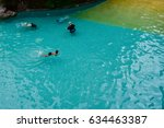 happy children swimming in the... | Shutterstock . vector #634463387