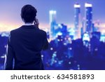 young businessman on his back... | Shutterstock . vector #634581893