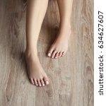 slender female legs and feet... | Shutterstock . vector #634627607