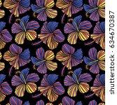 hibiscus flowers on black... | Shutterstock . vector #634670387