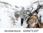 woman walking on a hiking trail ... | Shutterstock . vector #634671107