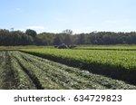 migrant workers working to...   Shutterstock . vector #634729823