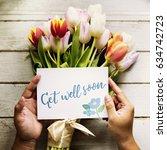 hand holding show get well soon ... | Shutterstock . vector #634742723