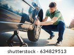 man changing wheel after a car...   Shutterstock . vector #634829513