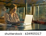 middle age female working on... | Shutterstock . vector #634905317