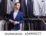 stylish man in a clothing... | Shutterstock . vector #634909277