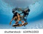 man and woman skateboarding... | Shutterstock . vector #634961003