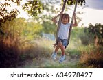 cute child  boy  having fun on... | Shutterstock . vector #634978427