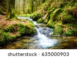 waterfall green forest river... | Shutterstock . vector #635000903