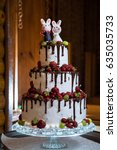 three tiered wedding cake with... | Shutterstock . vector #635035733
