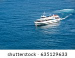 a tourist boat floats in the... | Shutterstock . vector #635129633