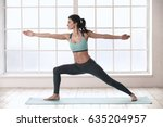 young woman doing yoga pose... | Shutterstock . vector #635204957