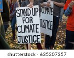 group of demonstrators hold a... | Shutterstock . vector #635207357