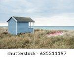 cute small beach hut by seaside ... | Shutterstock . vector #635211197