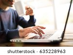 man typing on computer keyboard ... | Shutterstock . vector #635228963
