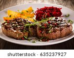 grilled beef steaks with... | Shutterstock . vector #635237927