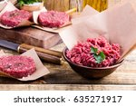 organic raw ground beef meat... | Shutterstock . vector #635271917