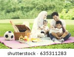 picture of muslim family using... | Shutterstock . vector #635311283