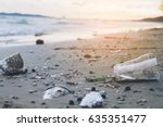 trash on sand beach showing... | Shutterstock . vector #635351477