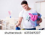 man doing laundry at home | Shutterstock . vector #635369207