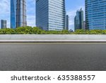 empty asphalt road front of... | Shutterstock . vector #635388557