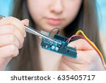 student girl in robotics lab | Shutterstock . vector #635405717