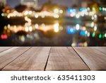wood desk empty for present... | Shutterstock . vector #635411303