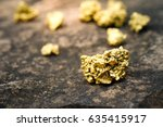 a lump of gold on a stone floor | Shutterstock . vector #635415917