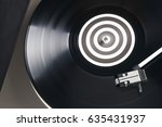 a vinyl record close up on a... | Shutterstock . vector #635431937