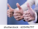 three business partners keeping ... | Shutterstock . vector #635496797