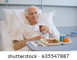 senior patient eating his lunch ... | Shutterstock . vector #635547887