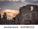 Small photo of The sky ablaze with the red/orange glow of the Italian sunset over the ancient ruins site of Pompeii, the degrading stonework masonry slowly falling into disrepair after 2 thousand years