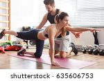 personal trainer helping sporty ... | Shutterstock . vector #635606753