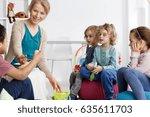 young smiling preschool teacher ... | Shutterstock . vector #635611703