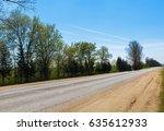 trees along the road. asphalt...   Shutterstock . vector #635612933