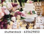 White Wedding Cake Decorated B...
