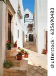 alleyway. locorotondo. puglia.... | Shutterstock . vector #635690483
