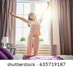 happy young woman enjoying... | Shutterstock . vector #635719187