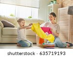 beautiful young woman and child ... | Shutterstock . vector #635719193