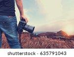 close up shot of man  holding... | Shutterstock . vector #635791043