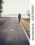 men walking on the way alone.   Shutterstock . vector #635799047