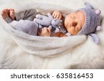 baby in cow suit lies on white... | Shutterstock . vector #635816453