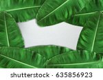 banana leaf on the table wood | Shutterstock . vector #635856923