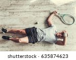 top view on young tennis player.... | Shutterstock . vector #635874623
