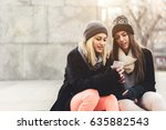 two girls hanging out in some... | Shutterstock . vector #635882543