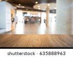 empty wooden table in front of... | Shutterstock . vector #635888963