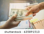 man offering batch of hundred... | Shutterstock . vector #635891513