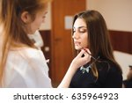 make up artist doing... | Shutterstock . vector #635964923