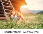 boy rest in green grass under... | Shutterstock . vector #635969693